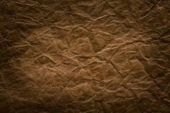 Fundo de papel áspero, textura vincada Brown envelhecida da página Imagem de Stock