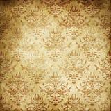 Fundo de papel amarelado velho com testes padrões florais Fotografia de Stock
