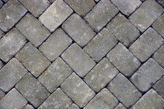 Fundo de pedra cinzento de pavimentar telhas na estrada fotografia de stock royalty free