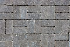 Fundo de pedra cinzento de pavimentar telhas na estrada fotografia de stock