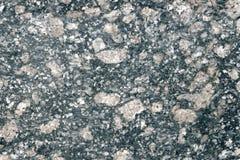 Fundo de pedra da rocha ígnea mottled do granito usada para os worktops etc imagem de stock royalty free