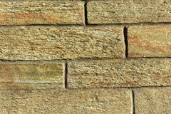 Fundo de pedra da textura dos tijolos Luz do por do sol imagem de stock royalty free