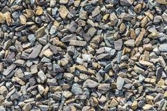 Fundo de pedras ásperas pequenas para pavimentar uma maneira foto de stock royalty free