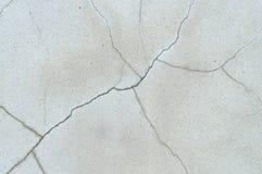 Fundo de rachamento estranho da textura do muro de cimento fotos de stock