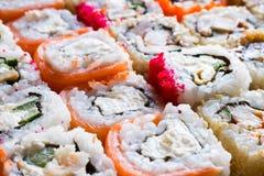 Fundo de rolos de sushi Fotografia de Stock