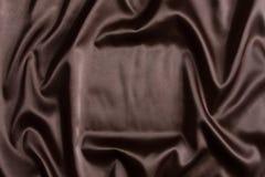 Fundo de seda de matéria têxtil de Brown fotografia de stock