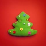 Fundo de Toy Christmas Tree On Red fotografia de stock