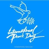 Fundo de Vecto para o dia internacional da paz Texto escrito da mão Olive Branch Cartaz internacional do dia da paz Fotos de Stock Royalty Free
