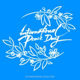 Fundo de Vecto para o dia internacional da paz Texto escrito da mão Olive Branch Cartaz internacional do dia da paz Foto de Stock