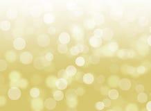 Fundo defocused do sumário do ouro de Bokeh do brilho imagens de stock royalty free