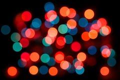 Fundo diferente colorido da luz de bulbo das cores, efeito da ampola, muita opinião colorida do sumário do bulbo, evento do ano no Fotografia de Stock