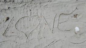 Fundo do amor da areia imagens de stock royalty free