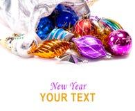 Fundo do ano novo com decorações coloridas Fotografia de Stock Royalty Free