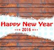 Fundo do ano novo feliz com flocos de neve e textura de madeira Fotos de Stock Royalty Free