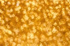 Fundo do bokeh do feriado do Natal com luzes do ouro Fundo dourado do bokeh do brilho fotografia de stock