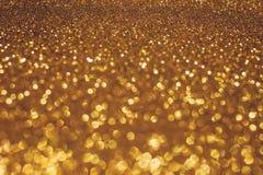 Fundo do bokeh do feriado do Natal com luzes do ouro Fundo dourado do bokeh do brilho fotos de stock