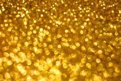 Fundo do bokeh do sumário do feriado do Natal com luzes do ouro Fundo do bokeh do brilho imagem de stock royalty free
