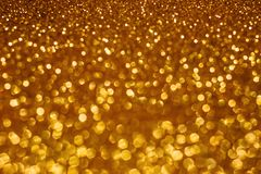 Fundo do bokeh do sumário do feriado do Natal com luzes do ouro Fundo dourado do bokeh do brilho imagens de stock royalty free
