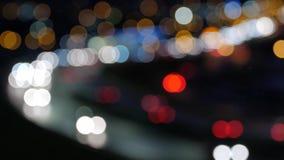 Fundo do borrão da cidade Círculos moventes do bokeh do tráfego da noite filme