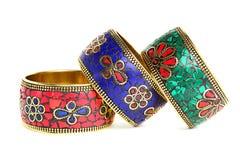 Fundo do branco de três braceletes Imagens de Stock Royalty Free