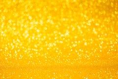 Fundo do brilho do bokeh da cor do ouro Fotos de Stock
