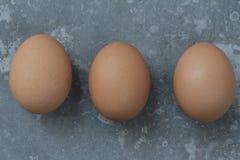 Fundo do clássico de três ovos Imagem de Stock Royalty Free