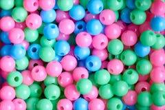 Fundo do close-up colorido dos grânulos fotografia de stock