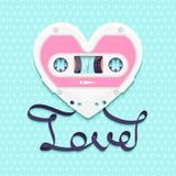 Fundo do dia de Valentim com a cassete áudio do vintage como o coração com texto do amor Fotos de Stock Royalty Free
