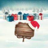 Fundo do inverno com caixas de presente e um ornamentado de madeira Fotos de Stock