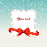 Fundo do inverno com um quadro e uma fita vermelha Imagem de Stock Royalty Free