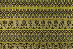 Fundo do marrom escuro e do verde com testes padrões geométricos Imagem de Stock