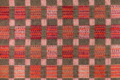 Fundo do marrom escuro e do vermelho com testes padrões geométricos Fotografia de Stock