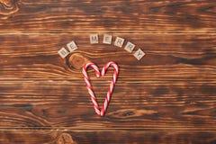 Fundo do Natal Bastões de doces, forma do coração Seja Foto de Stock
