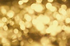 Fundo do Natal Brilho dourado do sumário do feriado Defocused Imagens de Stock