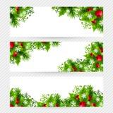 Fundo do Natal com as decorações do abeto e do azevinho Fotos de Stock Royalty Free