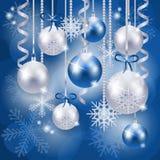 Fundo do Natal com as quinquilharias no azul Imagens de Stock Royalty Free