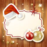 Fundo do Natal com etiqueta e chapéu Foto de Stock Royalty Free