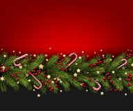 Fundo do Natal com ramo e azevinho do abeto Fotografia de Stock Royalty Free