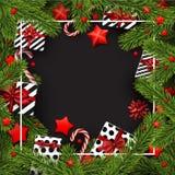 Fundo do Natal com ramos e presentes do abeto Fotografia de Stock Royalty Free