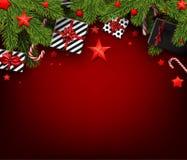 Fundo do Natal com ramos e presentes do abeto Fotos de Stock Royalty Free