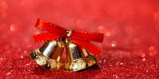 Fundo do Natal com sinos e brilho Fotografia de Stock Royalty Free