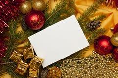 Fundo do Natal com um cartão em branco Foto de Stock Royalty Free