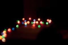 Fundo do Natal da foto com luzes da cor Fotografia de Stock