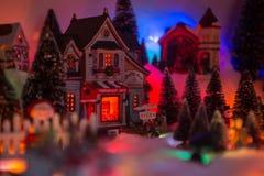Fundo do Natal da vila da miniatura do Natal imagens de stock