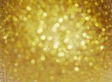 Fundo do Natal Fundo Defocused do brilho do sumário do feriado do ouro Bokeh obscuro Foto de Stock