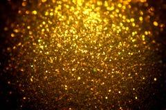 Fundo do Natal do brilho, textura brilhante, fundo da faísca do ouro Imagens de Stock