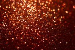 Fundo do Natal do brilho, textura brilhante, ouro e fundo vermelho da faísca Fotografia de Stock