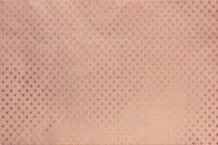 Fundo do ouro de Rosa do papel da folha de metal com um teste padrão de estrelas imagens de stock