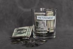 Fundo do planeamento de aposentação em um copo sem tampa Fotografia de Stock Royalty Free