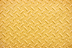 Fundo do teste padrão da placa do diamante do metal amarelo Foto de Stock Royalty Free